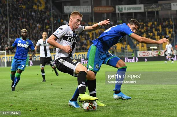 Dejan Kulusevski of Parma Calcio competes for the ball with Manuel Locatelli of US Sassuolo during the Serie A match between Parma Calcio and US...