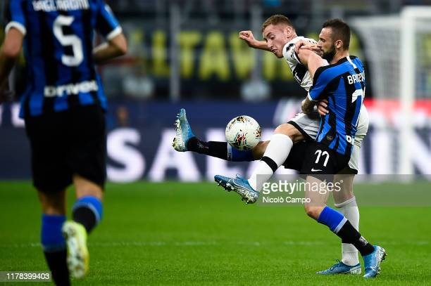 Dejan Kulusevski of Parma Calcio competes for the ball with Marcelo Brozovic of FC Internazionale during the Serie A football match between FC...