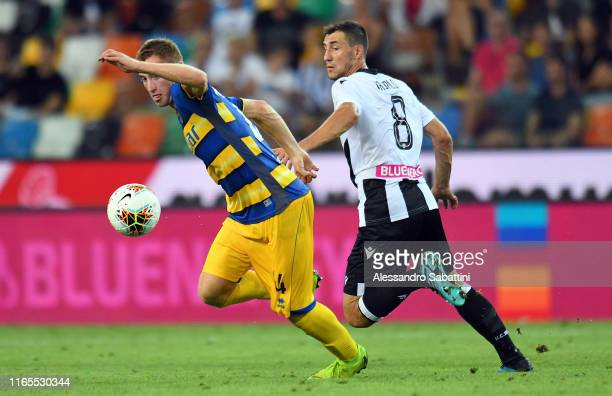 Dejan Kulusevski of Parma Calcio competes for the ball with Mato Jajalo of Udinese Calcio during the Serie A match between Udinese Calcio and Parma...