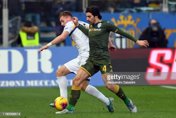 Dejan Kulusevski of Parma Calcio competes for the ball with Sandro Tonali of Brescia Calcio during the Serie A match between Parma Calcio and Brescia...