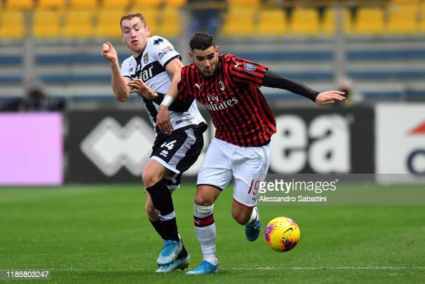 Dejan Kulusevski of Parma Calcio competes for the ball with Theo Hernandez of AC Milan during the Serie A match between Parma Calcio and AC Milan at...