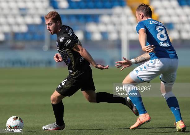 Dejan Kulusevski of Parma Calcio is challenged by Jaromir Zmrhal of Brescia Calcio during the Serie A match between Brescia Calcio and Parma Calcio...