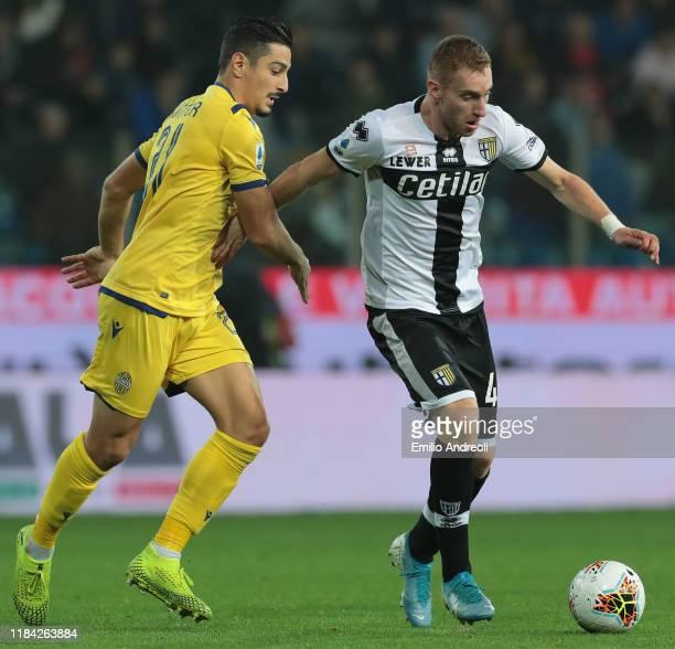 Dejan Kulusevski of Parma Calcio is challenged by Koray Gunter of Hellas Verona during the Serie A match between Parma Calcio and Hellas Verona at...