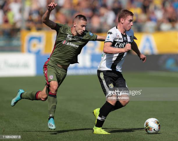 Dejan Kulusevski of Parma Calcio is challenged by Marko Rog of Cagliari Calcio during the Serie A match between Parma Calcio and Cagliari Calcio at...