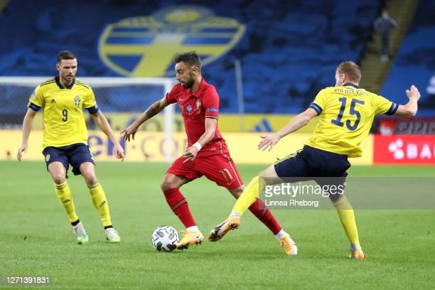 Dejan Kulusevski of Sweden and Bruno Fernandes of Portugal battle for the ball during the UEFA Nations League group stage match between Sweden and...