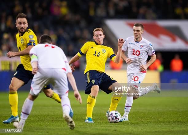 Dejan Kulusevski of Sweden and Sølvi Vatnhamar of Faroe Islands during the UEFA Euro 2020 Qualifier between Sweden and Faroe Islands on November 18...