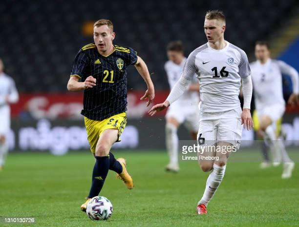 Dejan Kulusevski of Sweden runs with the ball whilst under pressure from Henrik Purg of Estonia during the International Friendly match between...