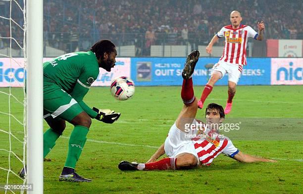 Dejan Lekic of Atletico de Kolkata and Chennaiyin FC goalkeeper Apoula Edel in action during their ISL semifinal second leg match at Yuva Bharati...