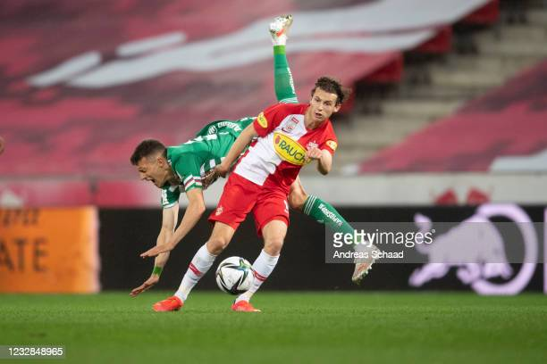 Dejan Ljubicic of Rapid Wien and Brenden Aaronson of Red Bull Salzburg battle for the ball during the tipico Bundesliga match between RB Salzburg and...