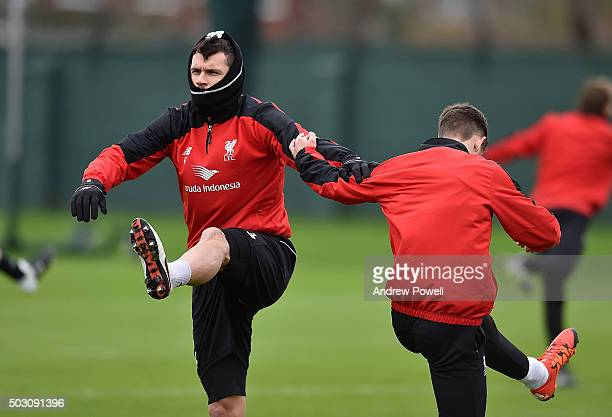Dejan Lovren and Alberto Moreno of Liverpool in action during a training session at Melwood Training Ground on January 1 2016 in Liverpool England