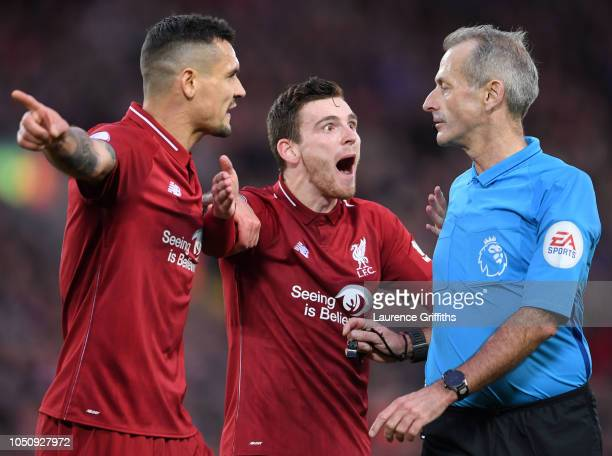 Dejan Lovren and Andrew Roberton of Liverpool argue with Referee Martin Atkinson during the Premier League match between Liverpool FC and Manchester...