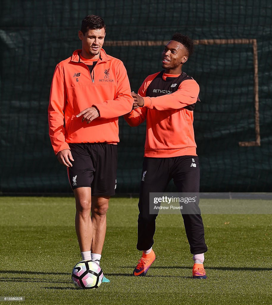 Dejan Lovren and Daniel Sturridge of Liverpool during a training session at Melwood Training Ground on October 19, 2016 in Liverpool, England.