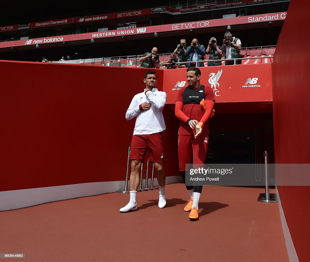 Dejan Lovren and Danny Ward of Liverpool arrives before the Training session at Anfield on May 21, 2018 in Liverpool, England.