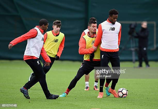 Dejan Lovren and Divock Origi of Liverpool during a training session at Melwood Training Ground on January 6 2017 in Liverpool England
