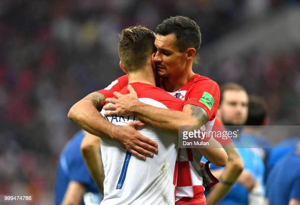 Dejan Lovren and Ivan Rakitic of Croatia look dejected following the 2018 FIFA World Cup Final between France and Croatia at Luzhniki Stadium on July...