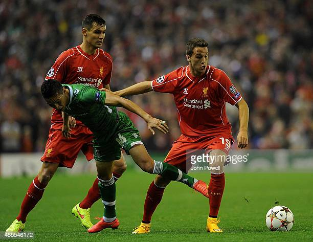 Dejan Lovren and Javier Manquillo of Liverpool and Marcelinho of PFC Ludogorets compete during the UEFA Champions League match between Liverpool and...
