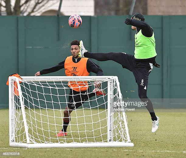 Dejan Lovren and Jerome Sinclair of Liverpool in action during a training session at Melwood Training Ground on February 12 2015 in Liverpool England