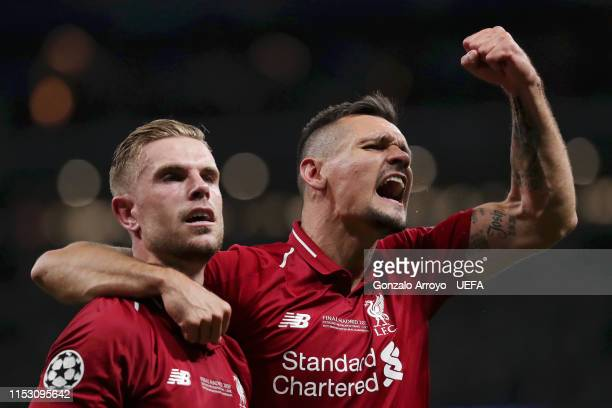Dejan Lovren and Jordan Henderson of Liverpool celebrate following the UEFA Champions League Final between Tottenham Hotspur and Liverpool at Estadio...
