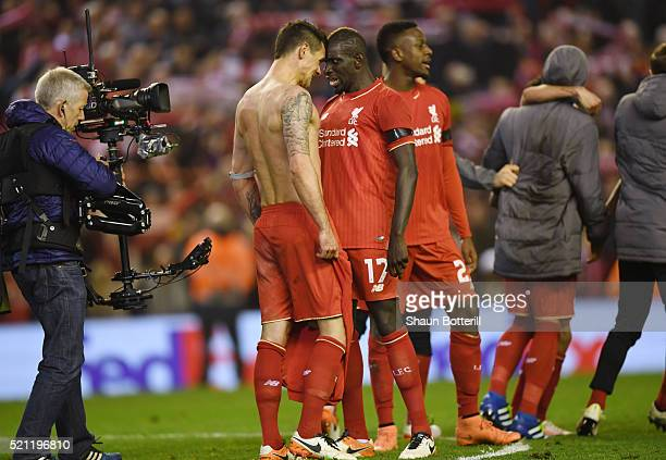 Dejan Lovren and Mamadou Sakho of Liverpool celebrate victory after the UEFA Europa League quarter final second leg match between Liverpool and...