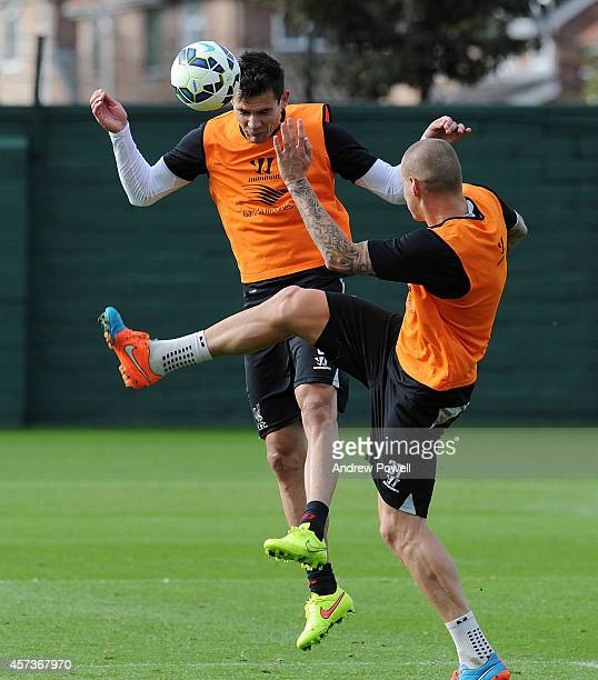 Dejan Lovren and Martin Skrtel of Liverpool in action during a training session at Melwood Training Ground on October 17 2014 in Liverpool England
