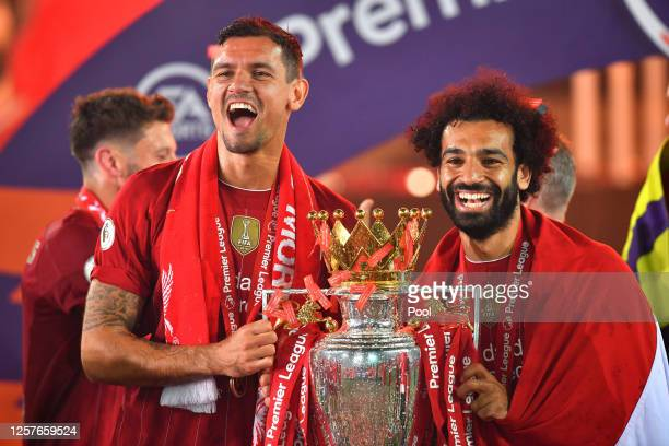 Dejan Lovren and Mohamed Salah of Liverpool celebrate with The Premier League trophy following the Premier League match between Liverpool FC and...