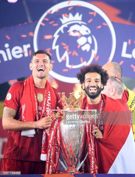 Dejan Lovren and Mohamed Salah of Liverpool celebrate with the Premier League Trophy after winning during the presentation ceremony of the Premier...