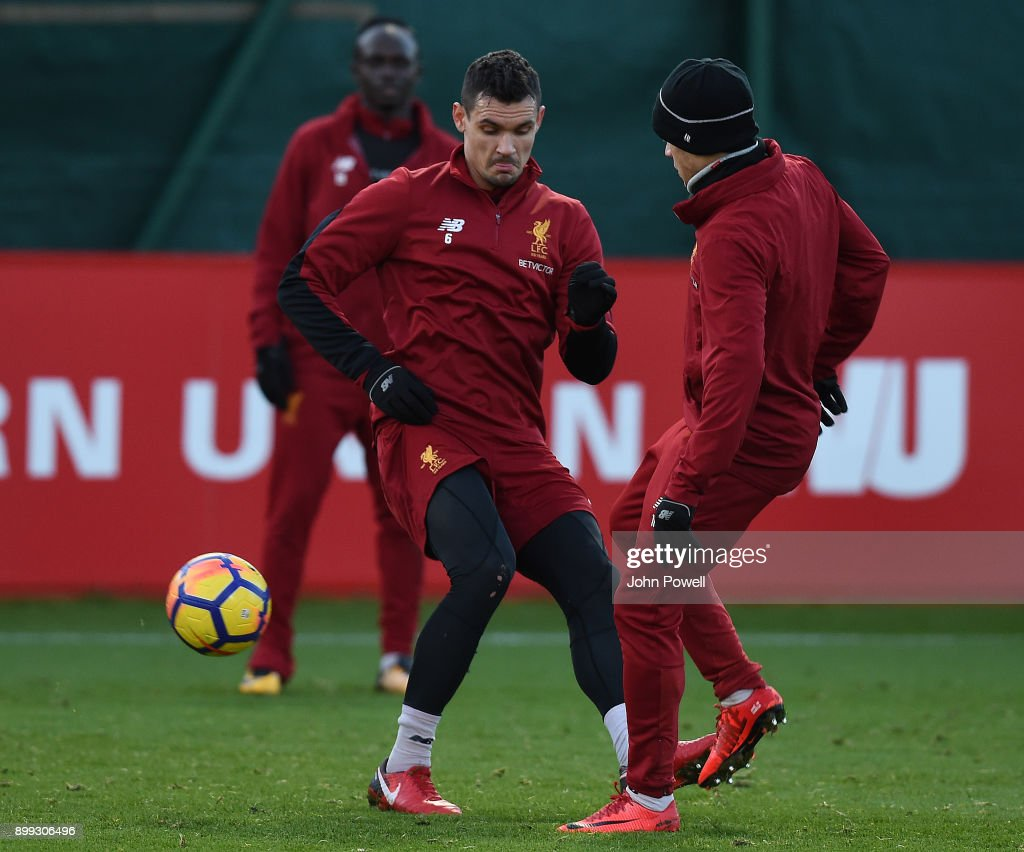 Dejan Lovren and Philippe Coutinho of Liverpool during a training session at Melwood Training Ground on December 28, 2017 in Liverpool, England.