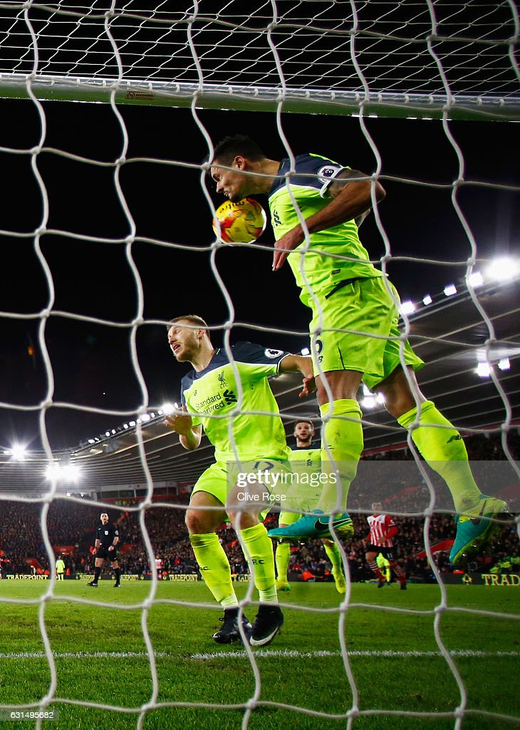 Dejan Lovren and Ragnar Klavan of Liverpool attempt to clear the ball as it hits the crossbar during the EFL Cup semi-final first leg match between Southampton and Liverpool at St Mary's Stadium on January 11, 2017 in Southampton, England.