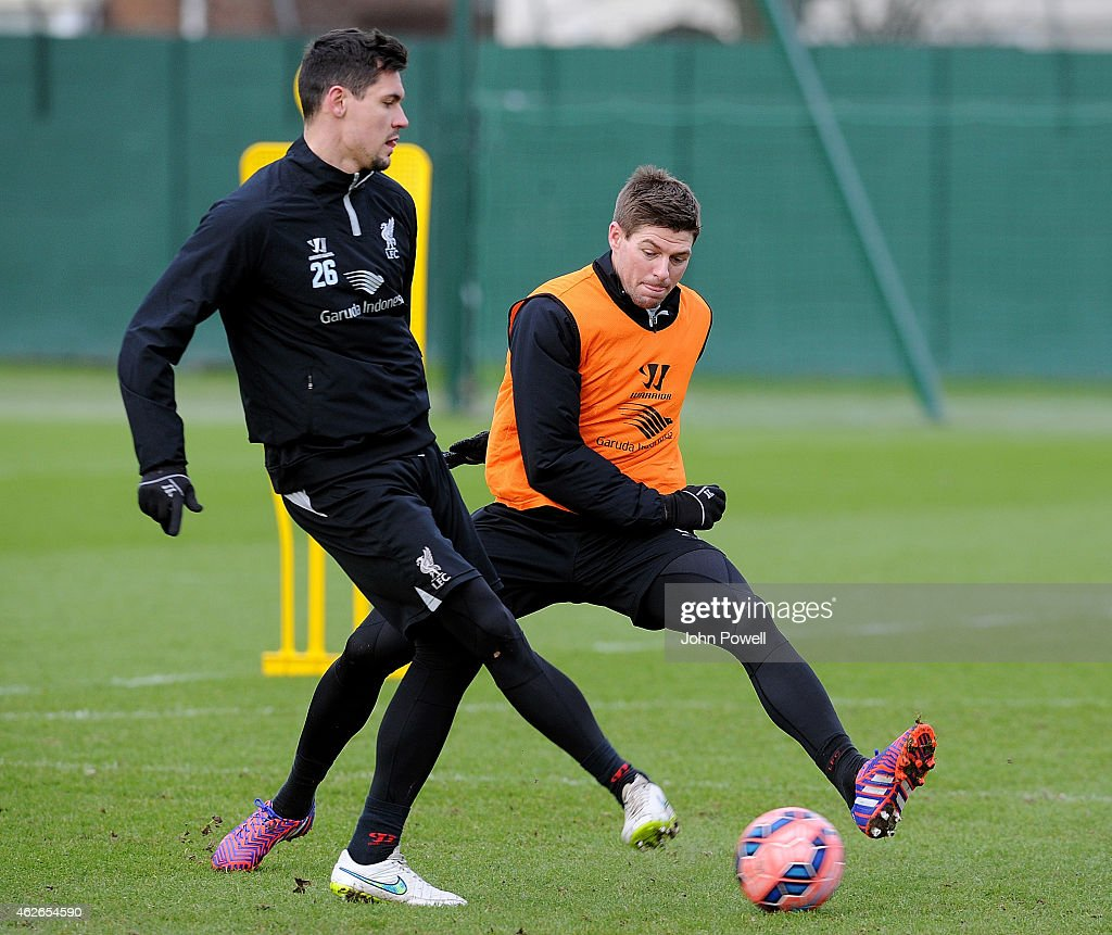 Dejan Lovren and Steven Gerrard of Liverpool during a training session at Melwood Training Ground on February 2, 2015 in Liverpool, England.