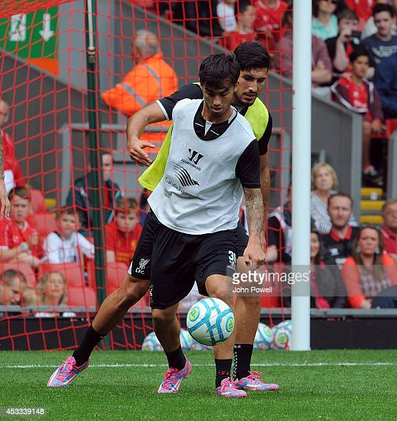 Dejan Lovren and Suso of Liverpool in action during a training session at Anfield on August 8 2014 in Liverpool England