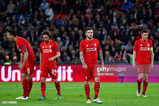 Dejan Lovren Joe Allen Alberto Moreno and James Milber of Liverpool looks on during the UEFA Europa League Final match between Liverpool and Sevilla...