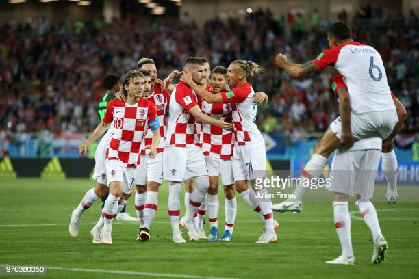 Dejan Lovren jumps on the back of Mario Mandzukic of Croatia as they celebrate after Oghenekaro Etebo of Nigeria scored an own goal during the 2018...