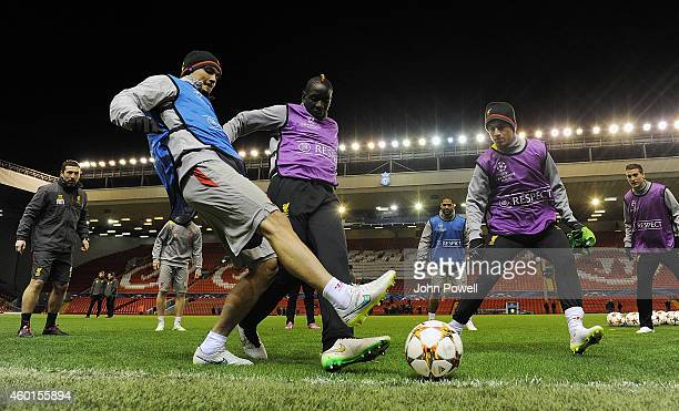Dejan Lovren Mamadou Sakho and Philippe Coutinho of Liverpool during a training session on December 8 2014 in Liverpool United Kingdom