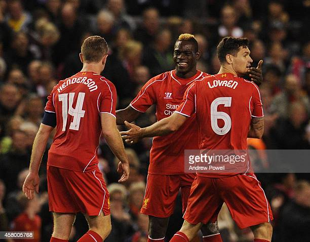 Dejan Lovren Mario Balotelli and Jordan Henderson of Liverpool celebrate the winning goal during the Capital One Cup Fourth Round match between...