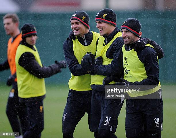 Dejan Lovren Martin Skrtel and Fabio Borini of Liverpool during a training session at Melwood Training Ground on December 12 2014 in Liverpool England