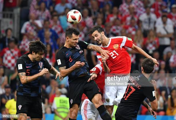 Dejan Lovren of Croatia and Aleksandr Yerokhin of Russia jump to head the ball during the 2018 FIFA World Cup Russia Quarter Final match between...