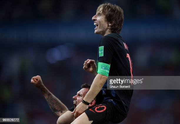 Dejan Lovren of Croatia and Luka Modric of Croatia celebrate following their sides victory in the 2018 FIFA World Cup Russia Quarter Final match...