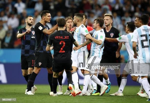 Dejan Lovren of Croatia and Nicolas Otamendi of Argentina clash after Nicolas Otamendi of Argentina kicks the ball into Ivan Rakitic of Croatia...