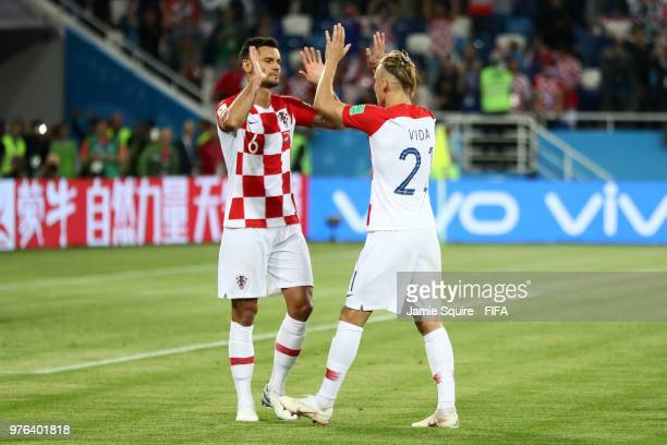 Dejan Lovren of Croatia celebrates with teammate Domagoj Vida following their sides victory in the 2018 FIFA World Cup Russia group D match between...