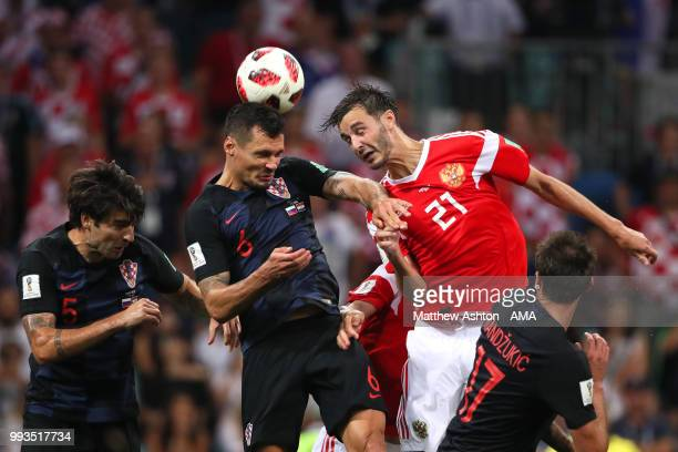 Dejan Lovren of Croatia competes with Aleksandr Erokhin of Russia during the 2018 FIFA World Cup Russia Quarter Final match between Russia and...