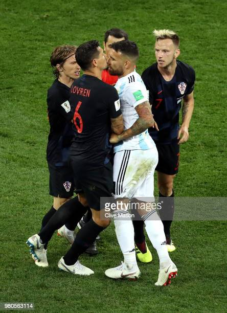 Dejan Lovren of Croatia confronts Nicolas Otamendi of Argentina after Nicolas Otamendi of Argentina kicks a ball into Ivan Rakitic of Croatia during...