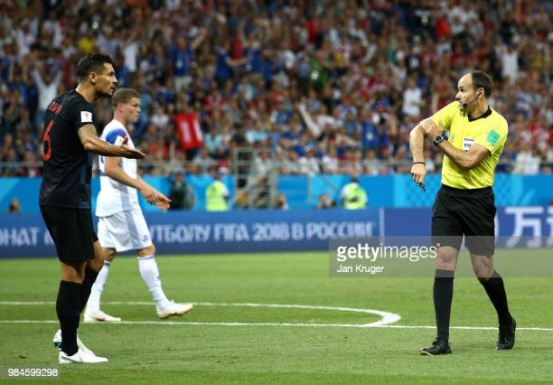 Dejan Lovren of Croatia confronts referee Antonio Mateu after he awards Iceland a penalty for a Dejan Lovren of Croatia hand ball inside the penalty...