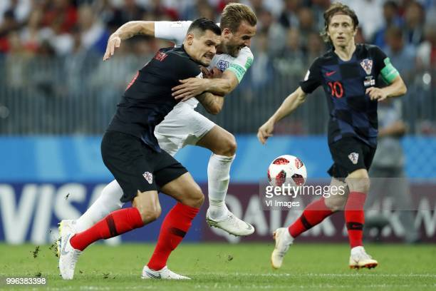 Dejan Lovren of Croatia Harry Kane of England Luka Modric of Croatia during the 2018 FIFA World Cup Russia Semi Final match between Croatia and...