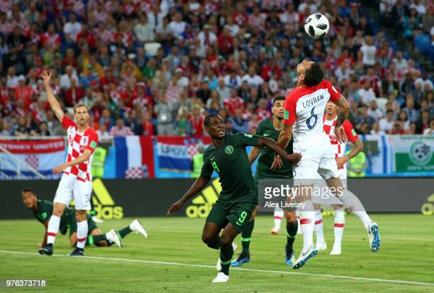 Dejan Lovren of Croatia heads clear from Odion Ighalo of Nigeria during the 2018 FIFA World Cup Russia group D match between Croatia and Nigeria at...