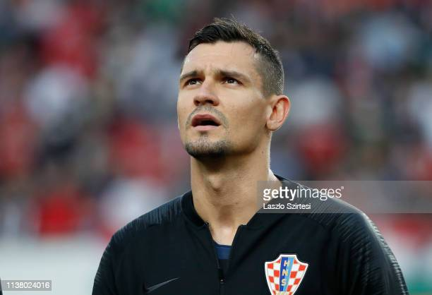 Dejan Lovren of Croatia listens to the anthem prior to the 2020 UEFA European Championships group E qualifying match between Hungary and Croatia at...