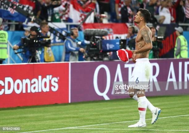 Dejan Lovren of Croatia removes his shirt in order to give it to fans following his sides victory in the 2018 FIFA World Cup Russia group D match...