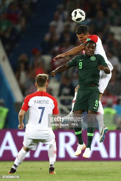 Dejan Lovren of Croatia wins a header from Odion Ighalo of Nigeria during the 2018 FIFA World Cup Russia group D match between Croatia and Nigeria at...