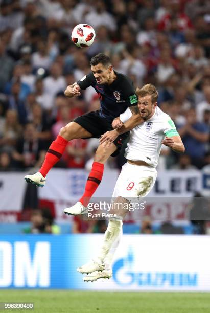 Dejan Lovren of Croatia wins a header over Harry Kane of England during the 2018 FIFA World Cup Russia Semi Final match between England and Croatia...