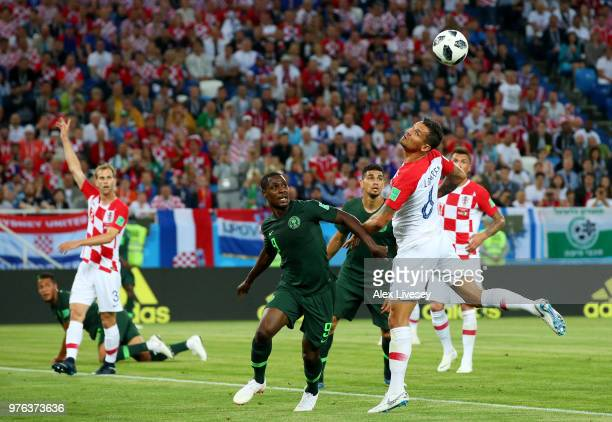 Dejan Lovren of Croatia wins a header over Odion Ighalo of Nigeria during the 2018 FIFA World Cup Russia group D match between Croatia and Nigeria at...