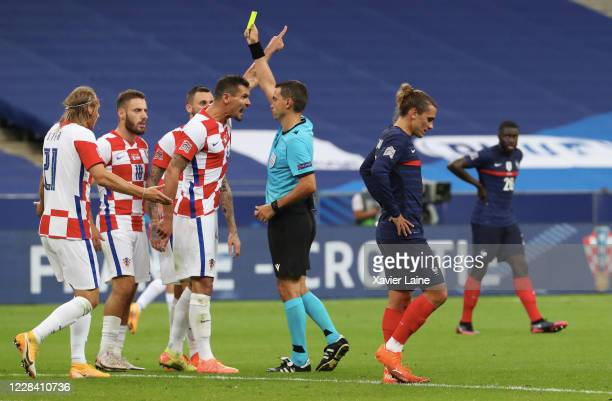 Dejan Lovren of Crotia reacts after receiving a yellow card by the referee during the UEFA Nations League group stage match between France and...